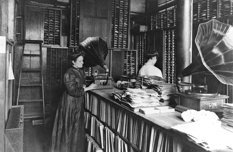 Women listening to records on early phonographs